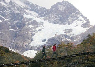 Explorers-crossing-a-river-Patagonia-Chile.-Hiking-trips-trekking-mgv19caj8ylm7lktw6vkesuao073lkkgdvnrp9w420